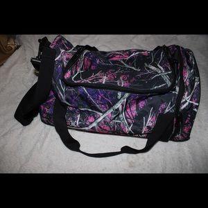 Muddy girl duffel bag